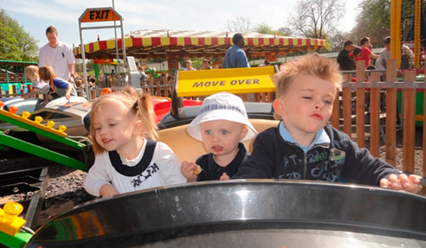 Young children having fun on a ride