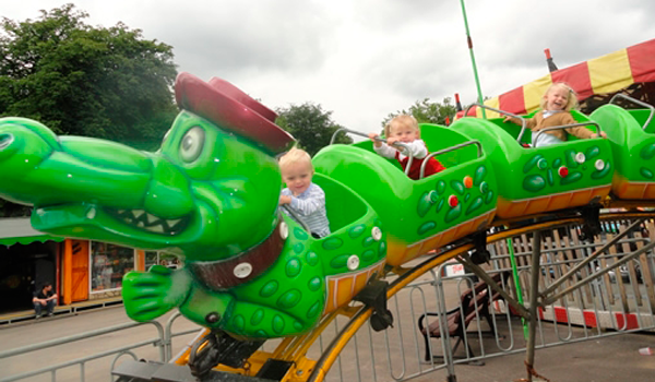 Young children having fun on dragon ride