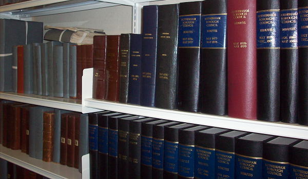 Archived documents on storage shelves.